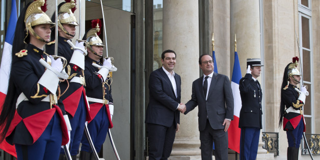 Greek Prime Minister Alexis Tsipras, left, is welcomed by French President Francois Hollande at the Elysee Palace in Paris, France, Wednesday, April 13, 2016. Greek Prime Minister Alexis Tsipras meets French President Francois Hollande after talks between Greece and its bailout creditors over the country's next economic reforms efforts. (AP Photo/Michel Euler)