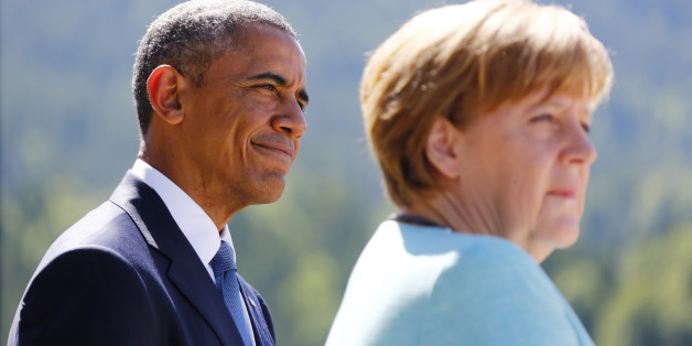 U.S. President Barack Obama and German Chancellor Angela Merkel make speeches after signing the guest book in Kruen, Germany June 7, 2015. Leaders from the Group of Seven (G7) industrial nations met on Sunday in the Bavarian Alps for a summit overshadowed by Greece's debt crisis and ongoing violence in Ukraine.  REUTERS/Matthias Schrader/Pool