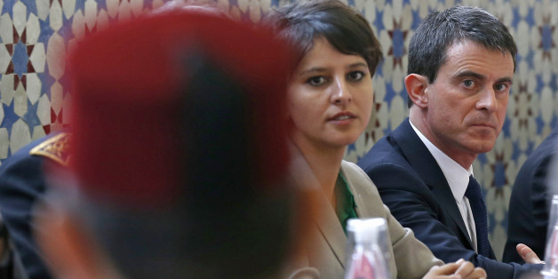 France's Prime Minister Manuel Valls (R) and Education and Research minister Najat Vallaud-Belkacem (L) attend a meeting with regional representatives of the Muslim community at Strasbourg Grand Mosque in Strasbourg, March 3, 2015.