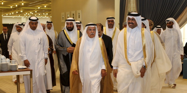 Qatar's Oil Minister Mohammed Saleh al-Sada (R) walks with Saudi Arabia's Oil Minister Ali al-Naimi as they arrive for a meeting of Gulf states' oil ministers in Doha, September 10, 2015. Gulf energy producers will continue to invest to maintain stable energy supplies, Qatar's Oil Minister Mohammed al-Sada said in Doha on Thursday ahead of a meeting of Gulf states' oil ministers. REUTERS/Naseem Zeitoon