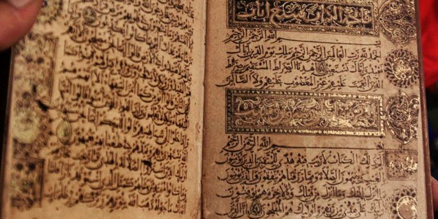 This is a handwritten manuscript of the Qurran by Ibn al-Bawab, a renowned seventh century caligraphist, shown at the new Biblioteca Alexandrina library in Alexandria, Egypt Wednesday, August 1, 2001. The book was the first placed on the shelves of the library during a ceremony Wednesday. The library will officially open its doors to the public on April 23, 2002. (AP Photo/Amr Nabil)