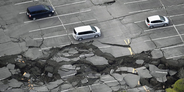 Cracks caused by an earthquake is seen at a parking lot in Minamiaso town, Kumamoto prefecture, southern Japan, in this photo taken by Kyodo April 16, 2016. Mandatory credit REUTERS/Kyodo  ATTENTION EDITORS - FOR EDITORIAL USE ONLY. NOT FOR SALE FOR MARKETING OR ADVERTISING CAMPAIGNS. THIS IMAGE HAS BEEN SUPPLIED BY A THIRD PARTY. IT IS DISTRIBUTED, EXACTLY AS RECEIVED BY REUTERS, AS A SERVICE TO CLIENTS. MANDATORY CREDIT. JAPAN OUT. NO COMMERCIAL OR EDITORIAL SALES IN JAPAN.