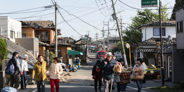 KUMAMOTO, JAPAN - APRIL 16: Local residents evacuate from the town centre on April 16, 2016 in Kumamoto, Japan. Following a 6.4 magnitude earthquake on April 14th, the Kumamoto prefecture was once again struck by a 7.3 magnitude earthquake, killing 9 people. (Photo by Taro Karibe/Getty Images)