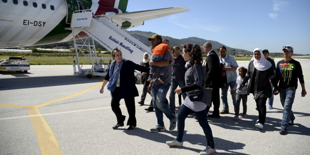 A group of Syrian refugees arrive to board a plane with Pope Francis at the airport of Mytilene, in the Greek island of Lesbos, April 16, 2016. REUTERS/Filippo Monteforte/Pool