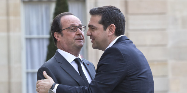 French President Francois Hollande, left, welcomes Greek Prime Minister Alexis Tsipras at the Elysee Palace in Paris, France, Wednesday, April 13, 2016. Greek Prime Minister Alexis Tsipras meets French President Francois Hollande after talks between Greece and its bailout creditors over the country's next economic reforms efforts. (AP Photo/Michel Euler)