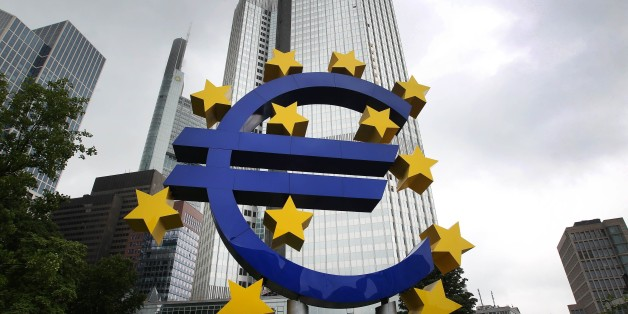 German artist Ottmar Hörl 's sculpture depicting the Euro logo is pictured in front of the former headquarter of the European Central Bank (ECB) in Frankfurt am Main, western Germany, on July 20, 2015 as Greece has begun making a 4.2 billion euro ($4.6 billion) payment due to the ECB as well as outstanding sums due to the International Monetary Fund (IMF) according to a ministerial source. The transfer was made possible by a short-term 'bridge' loan of 7.16 billion euros granted by the European Union on July 17, 2015.