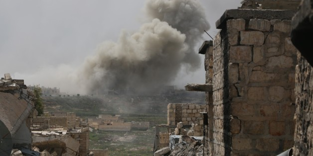 ALEPPO, SYRIA - APRIL 8 :  Smoke rises after Russian air-strikes hit opposition controlled areas as clashes between Syrian oppositions and regime forces continue at Handarat region of Aleppo, Syria on April 8, 2016. (Photo by Beha el Halebi/Anadolu Agency/Getty Images)