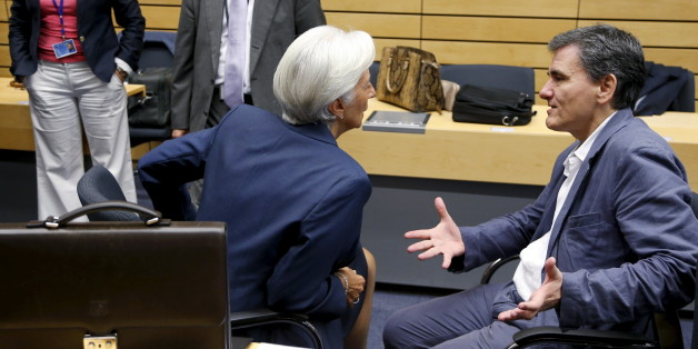"Greek Finance Minister Euclid Tsakalotos talks to International Monetary Fund (IMF) Managing Director Christine Lagarde (L) during an euro zone finance ministers meeting in Brussels, Belgium, July 12, 2015. Euro zone leaders will fight to the finish to keep near-bankrupt Greece in the euro zone on Sunday after the European Union's chairman cancelled a planned summit of all 28 EU leaders that would have been needed in case of a ""Grexit"".  REUTERS/Francois Lenoir"