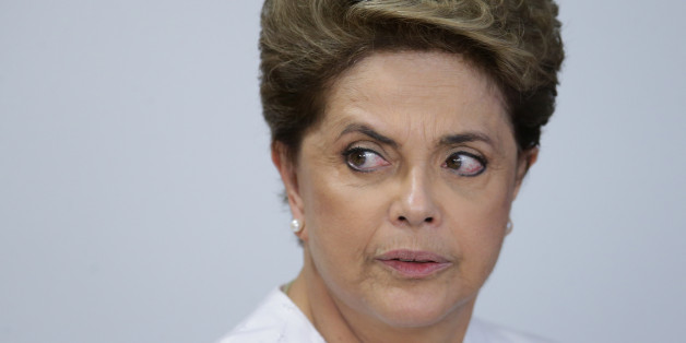Brazil's President Dilma Rousseff arrives for a meeting on state land issues, at Planalto presidential palace in Brasilia, Brazil, Friday, April 15, 2016. The lower chamber of Brazil's Congress began a debate on whether to impeach Rousseff, a question that underscores deep polarization in Latin America's largest country and most powerful economy. The crucial vote is slated for Sunday. (AP Photo/Eraldo Peres)
