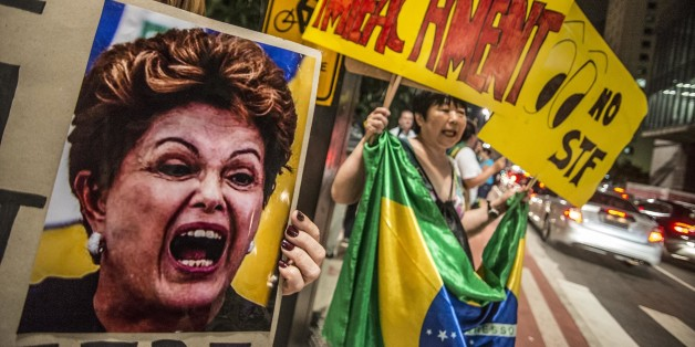 SAO PAULO, BRAZIL - APRIL 14:   A woman holds a banner during a protest against the government of president of Brazil Dima Roussef at Paulista Avenue on April 14, 2016 in Sao Paulo, Brazil.  Goverment of Brazil is attempting to block efforts to impeach President Dilma Roussefff by asking the Supreme Court to annul the process in Congress and suspend a key vote scheduled for Sunday. (Photo by Chris Faga/LatinContent/Getty Images)