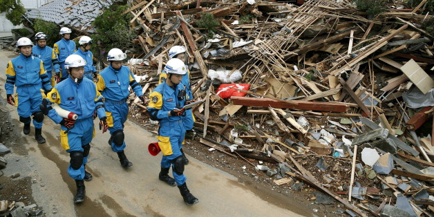 Police officers check a collapsed house after an earthquake in Mashiki town, Kumamoto prefecture, southern Japan, in this photo taken by Kyodo April 17, 2016. Mandatory credit REUTERS/Kyodo  ATTENTION EDITORS - FOR EDITORIAL USE ONLY. NOT FOR SALE FOR MARKETING OR ADVERTISING CAMPAIGNS. THIS IMAGE HAS BEEN SUPPLIED BY A THIRD PARTY. IT IS DISTRIBUTED, EXACTLY AS RECEIVED BY REUTERS, AS A SERVICE TO CLIENTS. MANDATORY CREDIT. JAPAN OUT. NO COMMERCIAL OR EDITORIAL SALES IN JAPAN.