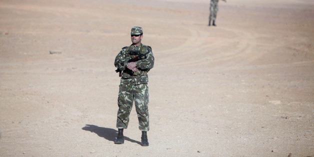 Soldiers stand guard at Krechba gas treatment plant, about 1200 km (746 miles) south of Algiers December 14, 2008. Algeria has approved or plans to approve projects expected to bring on up to 110,000 barrels per day (bpd) of crude oil output and 100,000 bpd of oil equivalents by 2012 or 2013, a Sonatrach official said on Sunday. REUTERS/Zohra Bensemra (ALGERIA)