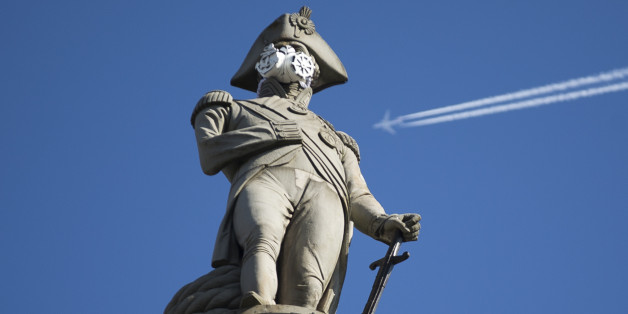 A clean air mask is seen placed on the top of Nelson's Column by Greenpeace activists to protest against air pollution quality in London and cities across the UK, in London, Monday, April 18, 2016. (AP Photo/Matt Dunham)