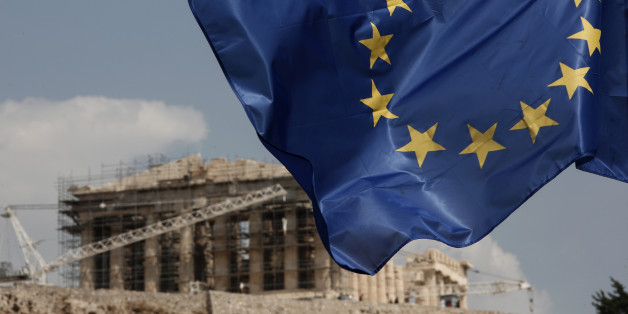 A European Union (EU) flag flutters in front of the temple of the Parthenon in Athens, Greece, Saturday, Aug. 15, 2015. Finance ministers of the 19-nation euro single currency group on Friday approved the first 26 billion euros ($29 billion) of a vast new bailout package to help rebuild Greece's shattered economy.  (AP Photo/Yorgos Karahalis)
