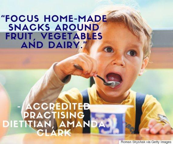 child eating yogurt