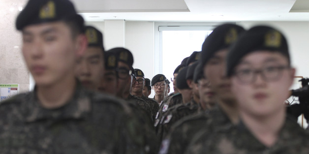South Korean army soldiers wait to cast their preliminary votes for the upcoming parliamentary election at a local polling station in Seoul, South Korea, Friday, April 8, 2016. The two-day preliminary votes began in the day, and it is the first time that the system is being applied in a nationwide parliamentary election. The rest of the voters go to the polls on April 13. (AP Photo/Ahn Young-joon)