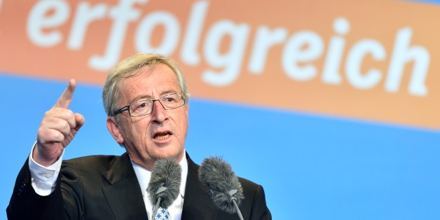 "The Christian Democratic frontrunner Jean-Claude Junker speaks during an election campaign event for the European election on 25 May 2014 in Worms, Germany, 24 May 2014. Letters in background read ""successful"". (AP Photo/dpa,Uwe Anspach)"