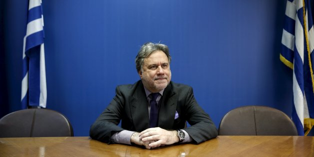 Greek Labour Minister George Katrougalos poses for a picture before an interview with Reuters at his office at the ministry in Athens, Greece, February 24, 2016. Greece's left-led government will not cut pensions again even if its international lenders demand it, the country's labour minister told Reuters on Thursday, saying the income of the weak will be protected.  REUTERS/Alkis Konstantinidis