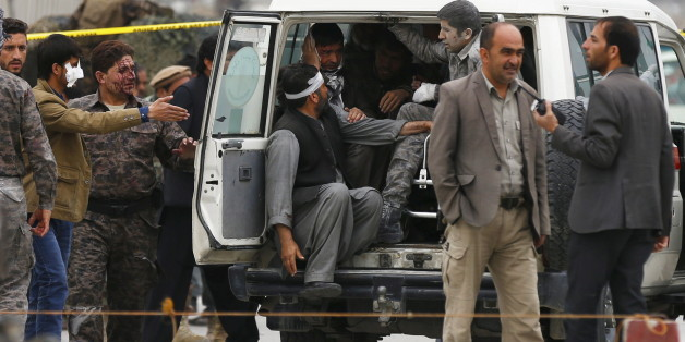 ATTENTION EDITORS - VISUAL COVERAGE OF SCENES OF INJURY OR DEATH Afghan security forces transport injured security personnel after a suicide car bomb attack in Kabul, Afghanistan April 19, 2016. REUTERS/Mohammad Ismail