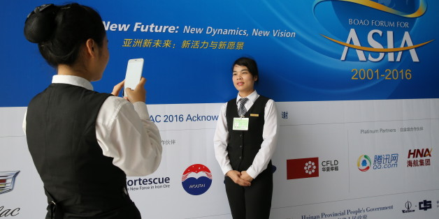 A member of the staff takes pictures with her mobile phone during Boao Forum in Boao, Hainan Province, March 22, 2016. REUTERS/China Daily ATTENTION EDITORS - THIS PICTURE WAS PROVIDED BY A THIRD PARTY. THIS PICTURE IS DISTRIBUTED EXACTLY AS RECEIVED BY REUTERS, AS A SERVICE TO CLIENTS. CHINA OUT. NO COMMERCIAL OR EDITORIAL SALES IN CHINA.