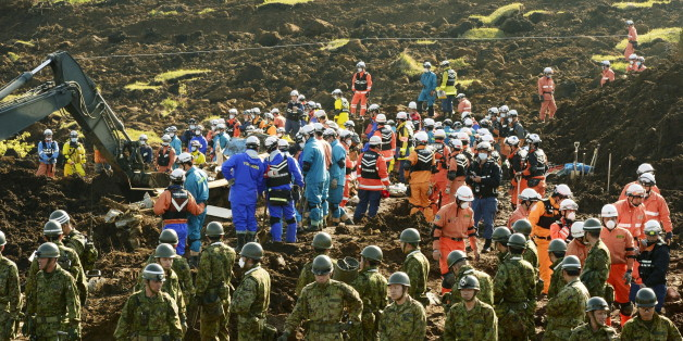 Rescue workers and Japan Ground Self-Defense Force soldiers conduct search and rescue operations at site where collapsed houses by a landslide caused by an earthquake in Minamiaso town, Kumamoto prefecture, Japan, in this photo taken by Kyodo April 20, 2016. Mandatory credit Kyodo/via REUTERS   ATTENTION EDITORS - THIS IMAGE WAS PROVIDED BY A THIRD PARTY. EDITORIAL USE ONLY. MANDATORY CREDIT. JAPAN OUT. NO COMMERCIAL OR EDITORIAL SALES IN JAPAN.
