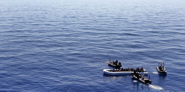 In this March 29, 2016 picture German Navy sailors and Special Forces from Finland help migrants prior to board the German combat supply ship 'Frankfurt am Main' during o EUNAVFOR MED Operation Sophia in the Mediterranean Sea off the coast of Libya .  (AP Photo/Matthias Schrader)