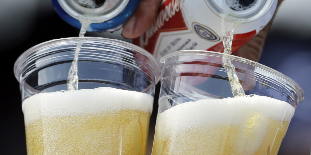 A vendor pours two beers to baseball fans  during the first inning of a baseball game between the Pittsburgh Pirates and the Chicago Cubs in Chicago, Sunday, July 7, 2013. (AP Photo/Nam Y. Huh)