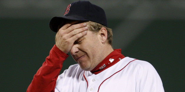 Boston Red Sox pitcher Curt Schilling reacts after giving up a home run to Cleveland Indians' Grady Sizemore during the fifth inning in Game 2 of Major League Baseball's ALCS playoff series in Boston, October 13, 2007. REUTERS/Brian Snyder  (UNITED STATES)