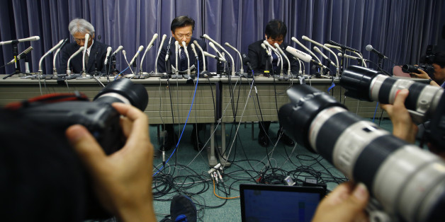 Mitsubishi Motors President Tetsuro Aikawa, center, listens to a reporter's question during a press conference in Tokyo, Wednesday, April 20, 2016. Mitsubishi Motors Corp. said Wednesday it used improper testing methods to make some of its vehicle models look more fuel efficient than they actually are. (AP Photo/Shizuo Kambayashi)