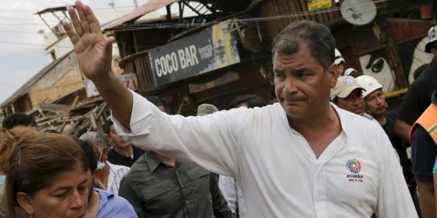 Ecuador's President Rafael Correa (R) greets residents during his visit after an earthquake struck off the Pacific coast, in town of Canoa, Ecuador, April 18, 2016. REUTERS/Henry Romero
