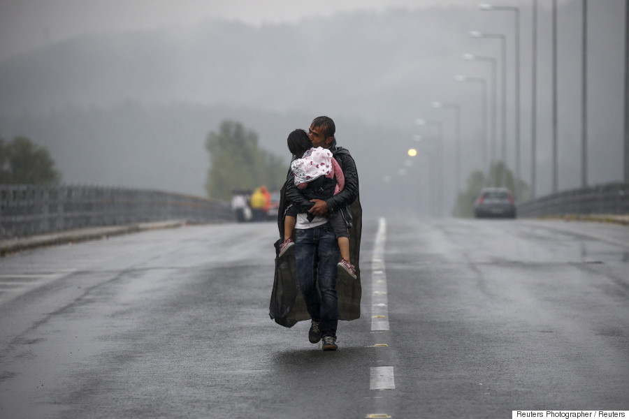 refugee kissing his daughter