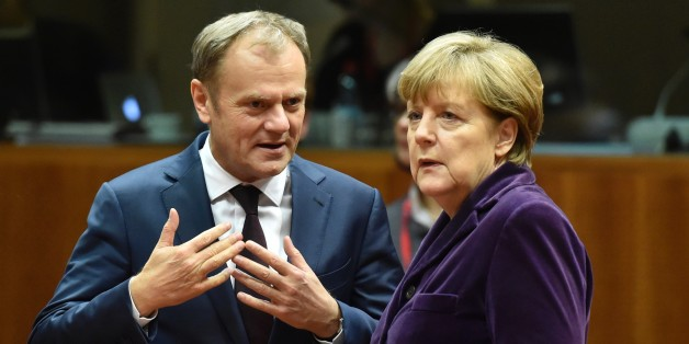European Council president Donald Tusk (L) speaks with German Chancellor Angela Merkel before the final European Union (EU) summit of the year at the European Council in Brussels on December 17, 2015.  EU leaders will discuss British Prime Minister David Cameron's controversial reform demands as well as plans for a new European border force to deal with the migration crisis. / AFP / ALAIN JOCARD        (Photo credit should read ALAIN JOCARD/AFP/Getty Images)