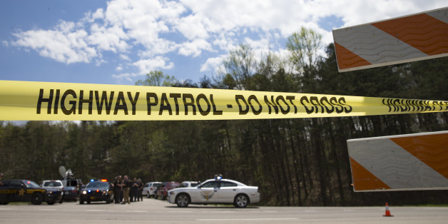 Police tape is deployed across from the Union Hill Road exit off Route 32 at a crime scene perimeter, Friday, April 22, 2016, in Pike County, Ohio. Shootings with multiple fatalities were reported along a road in rural Ohio on Friday morning, but details on the number of deaths and the whereabouts of the suspect or suspects weren't immediately clear. The attorney general's office said a dozen Bureau of Criminal Investigation agents had been called to Pike County, an economically struggling area