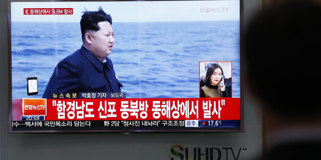 """A man watches a TV news program showing a file footage of North Korean leader Kim Jong Un at the Seoul Train Station in Seoul, South Korea, Saturday, April 23, 2016. North Korea on Saturday fired what appeared to be a ballistic missile from a submarine off its northeast coast, South Korean defense officials said, Pyongyang's latest effort to expand its military might in the face of pressure by its neighbors and Washington. The Korean letters read: """"North Korea fires submarine-launched ballistic"""