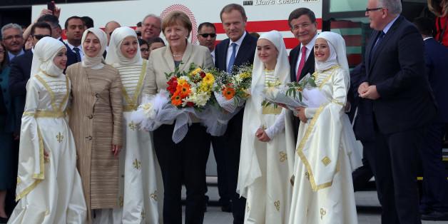 Angela Merkel mit EU-Ratspräsident Donald Tusk und dem türkischen Ministerpräsidenten Ahmet Davutoglu