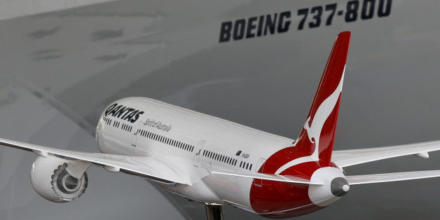 A model of a Boeing 787-9 Dreamliner in Qantas livery is shown during an event marking the 95th anniversary of the Airline at the Qantas Hangar at Sydney International Airport, November 16, 2015.   REUTERS/Jason Reed