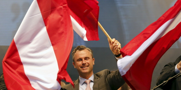 Austrian far right Freedom Party (FPOe) presidential candidate Norbert Hofer waves with Austrian flags during the final election rally in Vienna, Austria, April 22, 2016.   REUTERS/Leonhard Foeger