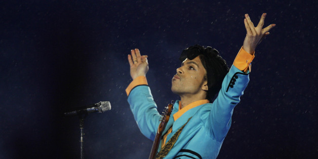 FILE- In this Feb. 4, 2007, file photo, Prince performs during the halftime show at Super Bowl XLI at Dolphin Stadium in Miami. In an industry where collaborations with other artists and credits are negotiated as heavily as world treaties, Prince followed only one credo when it came to working with others: the love of the music. Prince died Thursday, April 21, 2016, at his home outside Minneapolis. (AP Photo/Alex Brandon, File)