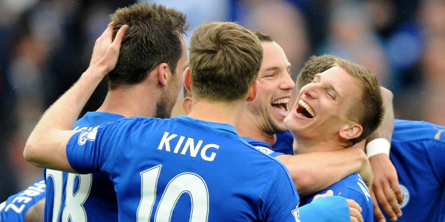Leicester's Marc Albrighton, center right, celebrates with team mates after scoring against Swansea during the English Premier League soccer match between Leicester City and Swansea City at the King Power Stadium in Leicester, England, Sunday, April 24, 2016. (AP Photo/Rui Vieira)