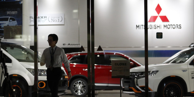 TOKYO, JAPAN - APRIL 20:  An employee  walks past a Mitsubishi Motors vehicles displayed at the company's headquarters on April 20, 2016 in Tokyo, Japan. Mitsubishi Motors share plunged more than 15% after the Japanese car maker announced it has mishandled the fuel economy test data.  (Photo by Tomohiro Ohsumi/Getty Images)