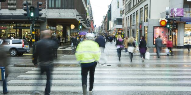 Sweden, Stockholm, pedestrians crossing street