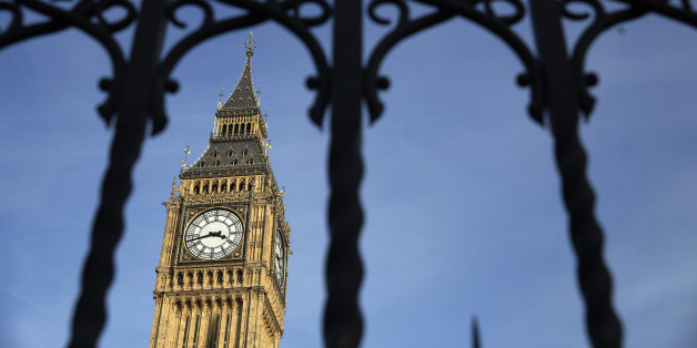 The Big Ben bell tower is seen behind the railings of the Houses of Parliament  in London, Britain February 22, 2016. Prime Minister David Cameron will try to sell his case for Britain remaining in the European Union to parliament on Monday, facing hostility from his own lawmakers and an exit campaign energised by the backing of London Mayor Boris Johnson.  REUTERS/Luke MacGregor