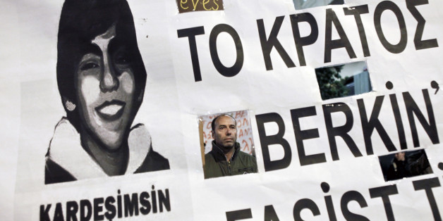 "A protester in seen through a banner depicting late Turkish Berkin Elvan during a rally in solidarity to the anti-government protesters in Turkey, in Athens March 13,2014. Turkey's Prime Minister Tayyip Erdogan condemned anti-government protesters on Thursday as ""charlatans"" bent on sowing chaos in the run-up to local elections after Turkey's worst civil unrest since mass protests last summer. Elvan, a 15-year-old boy who was wounded during anti-government demonstrations last summer died on Tues"