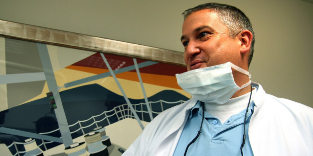 FILE - In this photo dated May 16, 2009 Dutch dentist, Jacobus Van Nierop, is pictured in his dental office in Chateau-Chinon, France.  A French court found a Dutch dentist guilty of assault and fraud Tuesday and sentenced him to eight years in prison. (AP Photo/Christophe Masson, File) FRANCE OUT