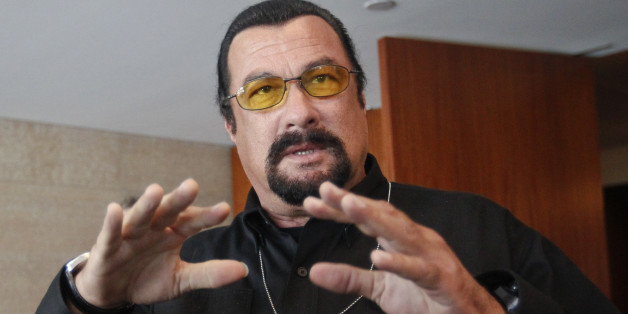 U.S. actor Steven Seagal speaks to the media at a news conference in Moscow June 2, 2013. U.S. lawmakers on a mission to Russia said on Sunday they had found no evidence that an American intelligence error enabled the Boston bombings, but that closer cooperation between Washington and Moscow might have helped to thwart the attack, in which three people died and 264 were injured.      REUTERS/Maxim Shemetov (RUSSIA - Tags: POLITICS CIVIL UNREST CRIME LAW ENTERTAINMENT)