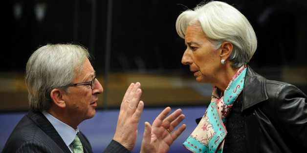 Luxembourg Prime Minister and President of the Eurogroup Council Jean-Claude Juncker (L) speaks with International Monetary Fund (IMF) chief Christine Lagarde on October 8, 2012 before a Eurogroup Council meeting  in Luxembourg. AFP PHOTO/JOHN THYS        (Photo credit should read JOHN THYS/AFP/GettyImages)