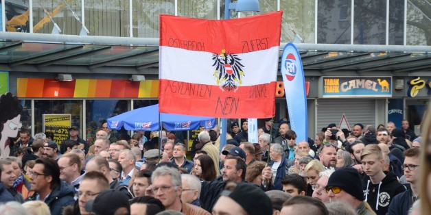 VIENNA, AUSTRIA  APRIL 18 : Anti-refugee far right Freedom Party of Austria (FPO) and Pro-refugee 'Platform for a humane asylum policy' group stage rival protests in Vienna, Austria on April 18, 2016. (Photo by Hasan Tosun/Anadolu Agency/Getty Images)