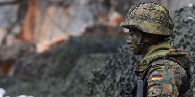 A mountain infantry soldier waits prior an exercise of the mountain infantry brigade 23 of the German Bundeswehr at an exercise area near the Bavarian village Bad Reichenhall, southern Germany, on March 23, 2016. / AFP / CHRISTOF STACHE        (Photo credit should read CHRISTOF STACHE/AFP/Getty Images)