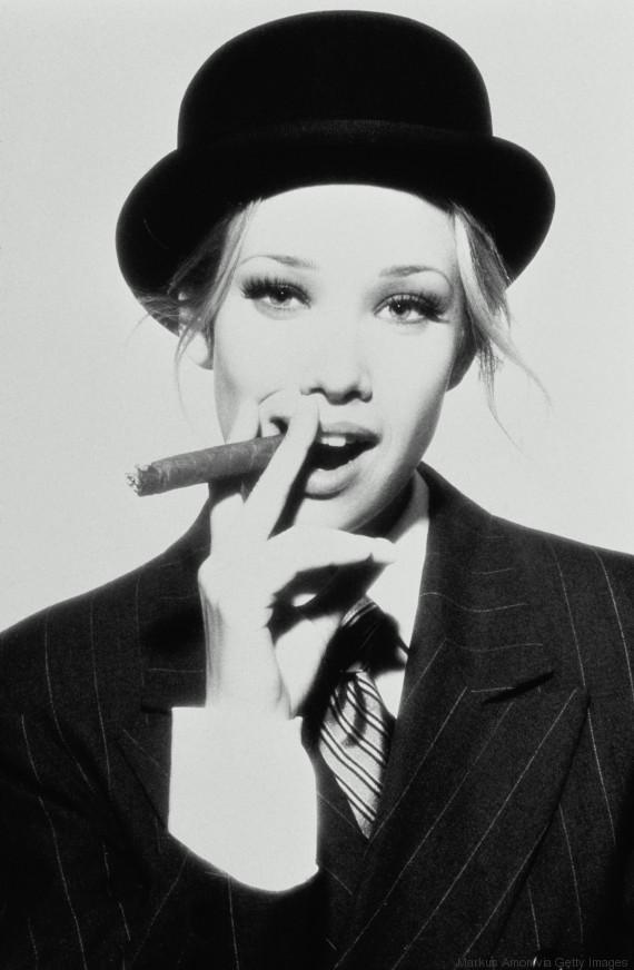 woman wearing suit hat smoking
