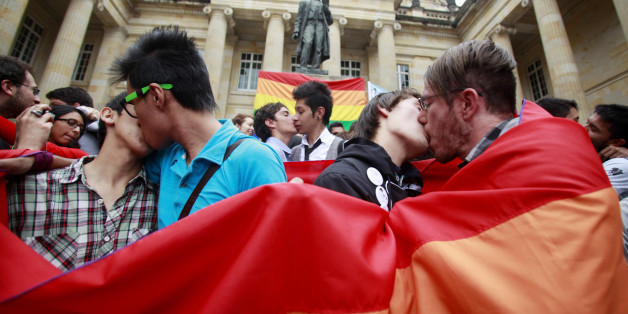 People kiss during a protest demanding the rights of the lesbian, gay, bisexual, and transgender (LGBT) community, at the Congress building in Bogota November 27, 2012. The protest was also against Senator Roberto Gerlein's recent derogatory comments on homosexuality during a debate on a proposed gay marriage bill in Congress, according to local media. REUTERS/John Vizcaino  (COLOMBIA - Tags: SOCIETY CIVIL UNREST POLITICS)
